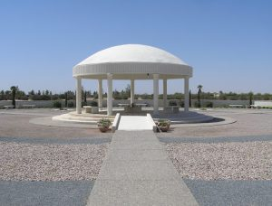 a serene white domed Pavilion with white columns and landscaped gardens